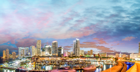 Magnificent dusk colors of Miami skyline, Florida. Panoramic sunset view.