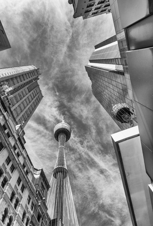 annually: SYDNEY - OCTOBER 2015: Sydney Tower on a beautiful day. The city attracts 10 million people annually.