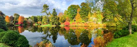 Beautiful lake and colourful trees of New England at foliage season, USA.