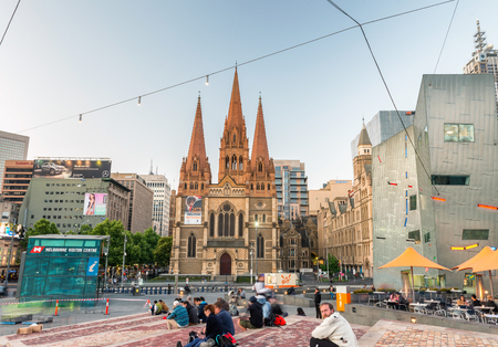 annually: MELBOURNE - OCTOBER 2015: Federation Square at night. The city attracts 10 million tourists annually. Editorial