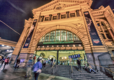 flinders: MELBOURNE - OCTOBER 2015: Flinders Street Station at night. The complex covers two whole city blocks.