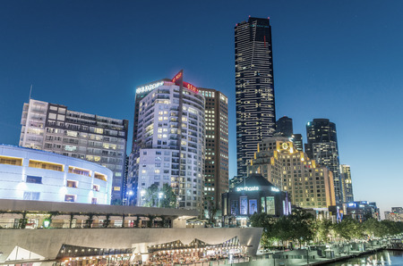 annually: MELBOURNE - OCTOBER 2015: Beautiful city skyline at night. melbourne attracts 10 million tourists annually.