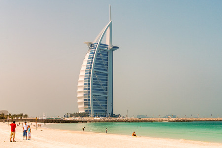 classed: DUBAI, UAE - JULY 2008: The grand sail shaped Burj al Arab Hotel on July 2008 in Dubai. The hotel is classed as one of the most luxurious in the world and is located on a man made island