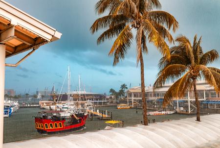 MIAMI - FEBRUARY 23, 2016: Miami port and ships. Miami welcomes 15 million visitors annually.