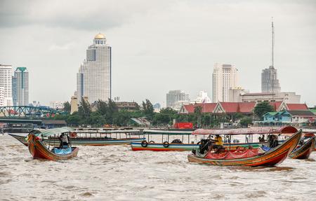 annually: BANGKOK - JULY 2008: City buildings over river Chao Phraya. Bangkok hosts 5 million tourists annually.