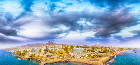 Magnificent sunset aerial view of Playa de Las Americas. beach and buildings of Tenerife, Spain.