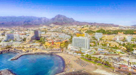 TENERIFE, SPAIN - SEPTEMBER 7, 2016: Panoramic aerial view of Playa de las Americas. Tenerife attracts 5 million people annually.