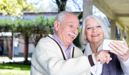 rehab: Happiness in elder rehab facility. Retired successful people.