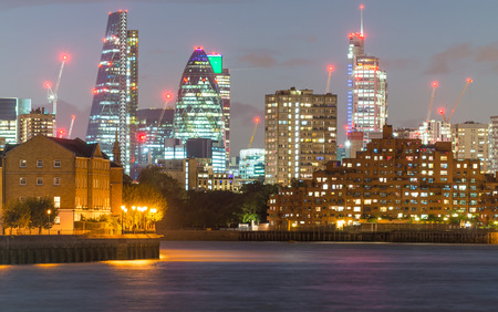 annually: LONDON - SEPTEMBER 26, 2016: Skyline of London City business district. London attracts 30 million people annually.