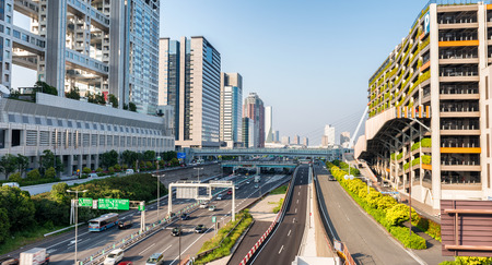 annually: TOKYO - MAY 22, 2016: Metropolitan Expressway in Odaiba Tokyo. The city attracts more than 10 million tourists annually. Editorial