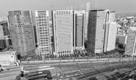 annually: TOKYO - MAY 23, 2016: Panoramic view of city skyline from Shinagawa rooftop. Tokyo attracts more than 10 million tourist annually.