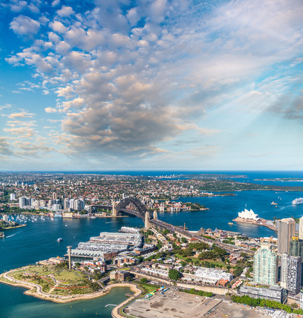 nsw: Magnificence of Sydney Harbour at sunaet, aerial view from helicopter.