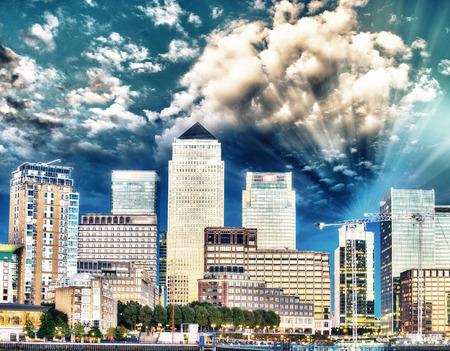 Canary Wharf night skyline over river Thames - London, UK.