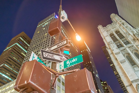 fifth avenue: One way signs at night on the Fifth Avenue, New York City. Stock Photo