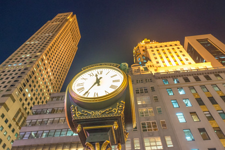 fifth avenue: NEW YORK - OCTOBER 23, 2015. The Trump Tower on Fifth Avenue and its clock at night, typical of the high-end mixed use skyscrapers common in Manhattan which combine both commercial and residential use. Editorial