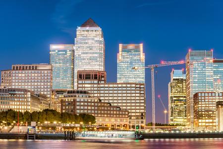 Night skyline of Canary Wharf. London buildings at sunset. Stock Photo