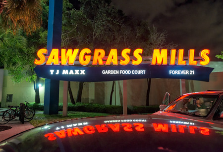 january sunrise: SUNRISE, FL - JANUARY 2016: Sawgrass Mills outlet entrance at nght. Sawgrass Mills is a shopping mall operated by the Simon Property Group.