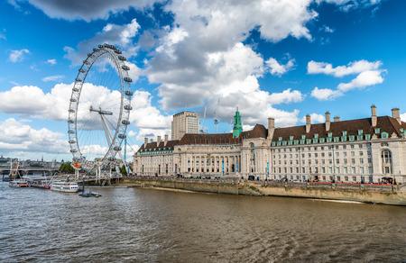 along: London buildings along Thames. Stock Photo