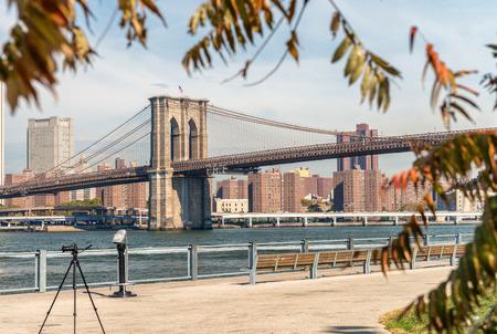Brooklyn Bridge framed by autumn trees. Stock Photo