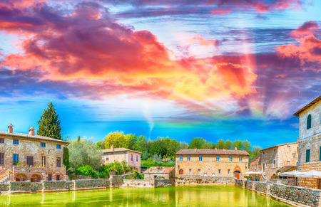 Bagno Vignoni at sunset. Medieval Tuscan Town, Italy.