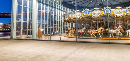 BROOKLYN, NY - JUNE 11, 2013: Historic Janes Carousel at night in Brooklyn, NY. This restored 1922 carousel is housed in the pavilion under Brooklyn Bridge and was built by Philadelphia Toboggan Comp.