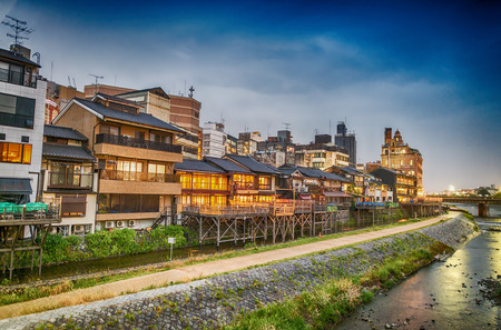 Kyoto, Japan. Sunset view of cityscape along river.