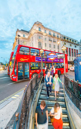 LONDON - JULY 3, 2015: Tourists and locals at Piccadilly subway station entrance. Underground is the preferred way of moving in London. Editorial