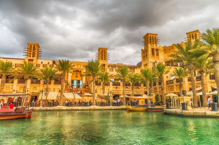 DUBAI, UAE - DECEMBER 10, 2016: View of Madinat Jumeirah on a cloudy day. Dubai attracts 15 million people every year.
