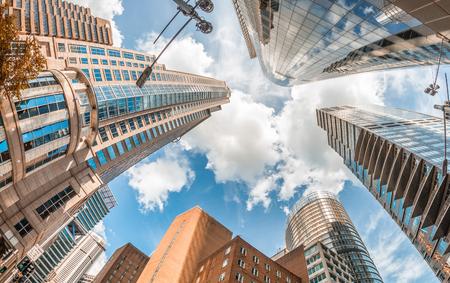 Skyward view of Sydney buildings against blue sky.