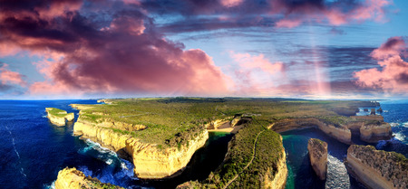 ard: Sunset panoramic aerial view of Loch Ard Gorge and Island Arch, Great Ocean Road - Australia.