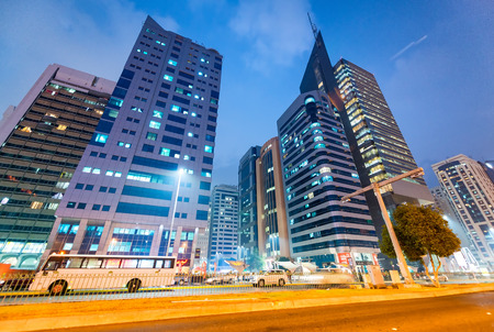 ABU DHABI, UAE - DECEMBER 7, 2016: Buildings in Downtown Abu Dhabi at night. The city attracts 10 million tourists annually. Editorial