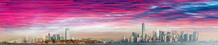 Jersey City, Ellis Island and Manhattan, panoramic view at dusk.