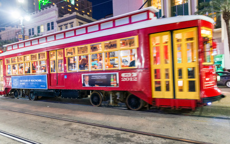 NEW ORLEANS, USA - FEBRUARY 11. 2016: Blurred view of New Orleans Streetcar Line in downtown at night. The New Orleans Streetcar line began electric operation in 1893. Editorial