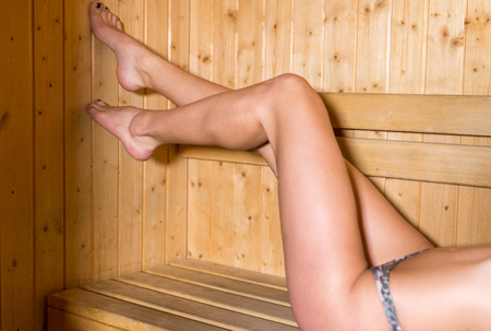 sauna nackt: Beautiful woman legs inside sauna room. Lizenzfreie Bilder