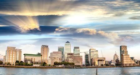 Sunset panoramic view of Canary Wharf buildings - London, UK. Stock Photo
