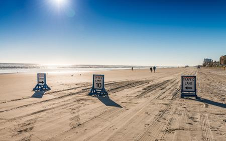 beachfront: Street signs on Daytona Beach along the ocean.