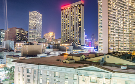 Night aerial skyline of New Orleans, Louisiana from rooftop.