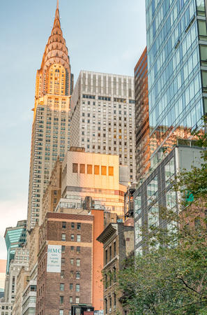 NEW YORK CITY - SEPTEMBER 2015: Street view of Chrysler building. New York attracts 50 million people annually. Editorial