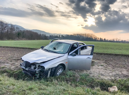 rusty car: Car accident. Wreckage at road side. Stock Photo