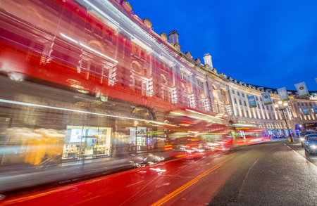 regent: LONDON - JUNE 2015: Traffic after sunset in Oxford Street. London attracts 30 million people annually.