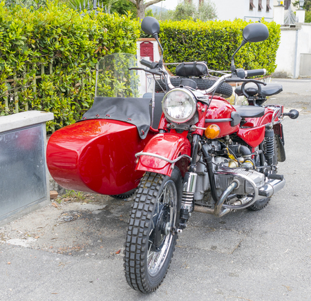 motor car: PISA, ITALY - MARCH 2014: Sidecar parked in a city street. Sidecar is used by many passionate people to travel in Tuscany.