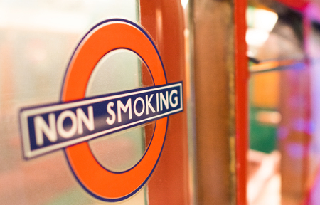 LONDON - JULY 2, 2015: No Smoking sign in the city. It is illegal to smoke in all enclosed work places in England.