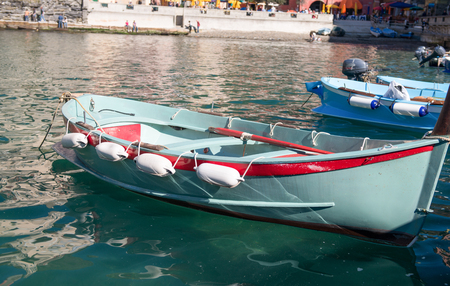 Colorful boats in the quaint port of Vernazza, Cinque Terre - Italy.