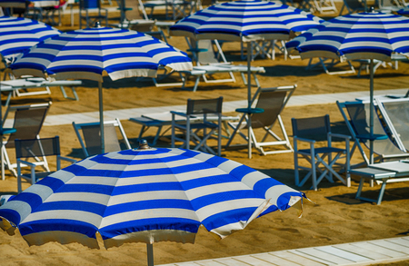 Rows of white and blue beach umbrellas.