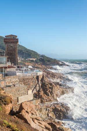 livorno: Calafuria, Leghorn - Italy. Ancient tower during a storm in Tuscany.