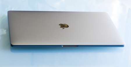 15 inch: PISA, ITALY - DECEMBER 2016: Macbook Pro 15 inches with touchbar. The fourth generation MacBook Pro was announced on October 27, 2016.