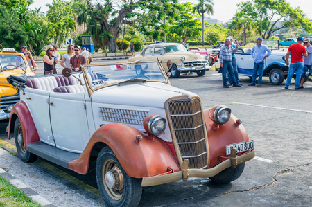 almost all: HABANA, CUBA - APRIL 5, 2016: Colourful old car in city street. Almost all the vehicles used are second hand in Cuba. Editorial