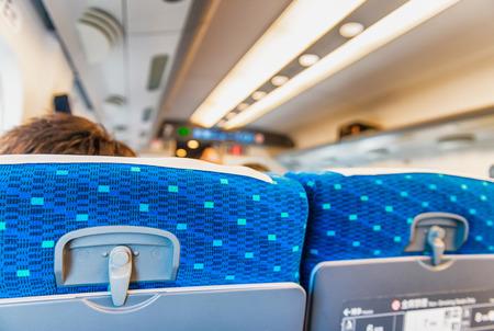 legroom: Back view of airplane passengers seats.