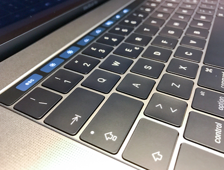 MASSA, ITALY - DECEMBER 13, 2016: New Macbook Pro with touch bar. This is a new technology from Apple. Editorial