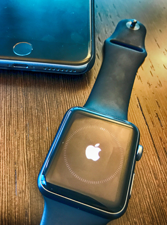 MASSA, ITALY - OCTOBER 19, 2016: Apple Watch on a table. It incorporates fitness tracking and health-oriented capabilities.